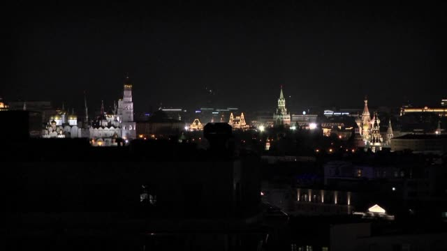 moscow's famous red square plunges into darkness for earth hour as part of a global campaign to raise awareness about climate change and its impact... - earth hour stock videos & royalty-free footage