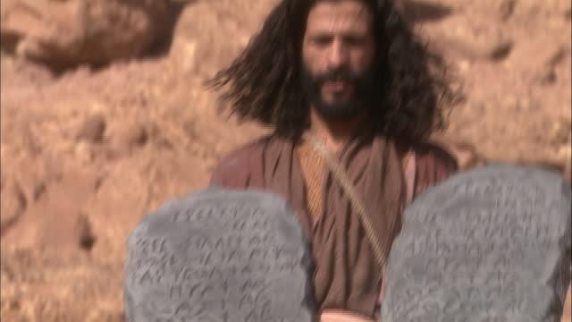 moses carries the ten commandments in the sahara desert. - historische nachstellung stock-videos und b-roll-filmmaterial
