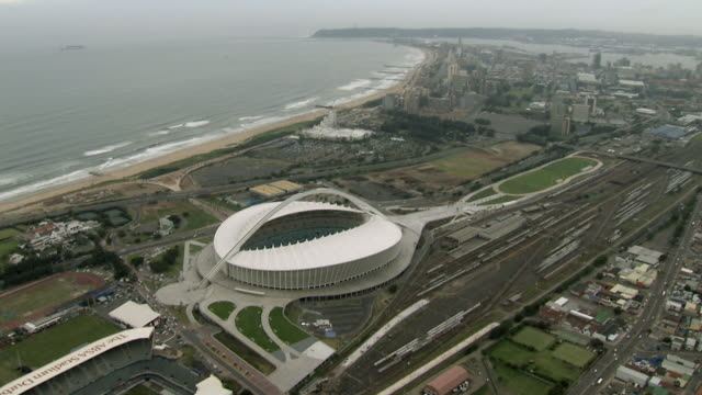 aerial moses mabhida stadium / durban, south africa - durban stock videos and b-roll footage
