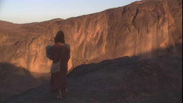 moses walks down mt. sinai carrying the ten commandments. - bible stock videos & royalty-free footage