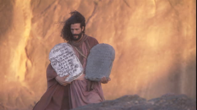 moses walks down mt. sinai with the ten commandments. - bible stock videos & royalty-free footage