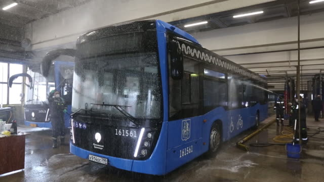mosgortrans passenger bus being cleaned and disinfected at service terminal in moscow, russia, on thursday, mar 19, 2020. - car wash stock videos & royalty-free footage