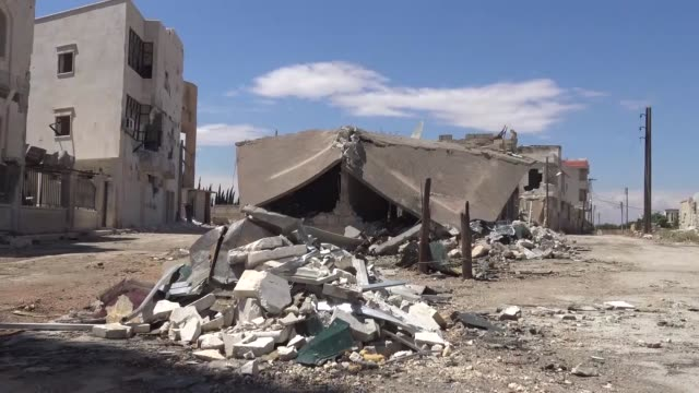A mosque and residential buildings have been destroyed in airstrikes of Syrian and Russian forces in AlQarasi village after it was captured by...