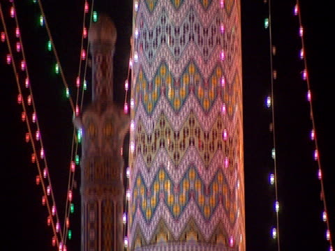 vídeos de stock e filmes b-roll de tu mosque at night featuring colorful, ornamental detail of one of the mosque's brightly lit iwans / qom, iran - formato letterbox