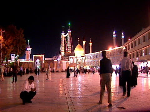 la mosque at night with a crowd of visitors in the public square / qom iran - circa 15th century stock videos & royalty-free footage