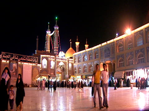 stockvideo's en b-roll-footage met la a mosque at night with crowd of visitors in the public square / qom iran - rond de 15e eeuw