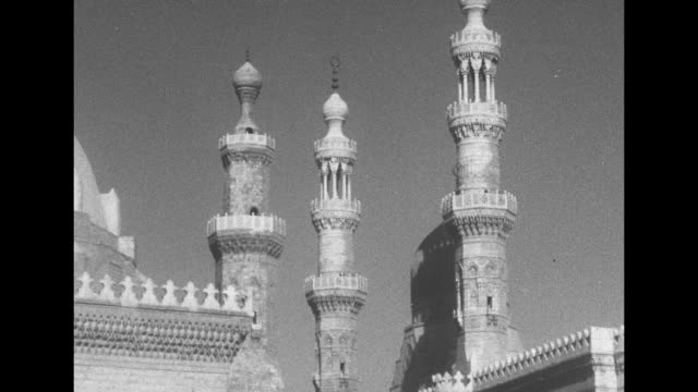 vs mosque exterior and minarets / ms mosque with camels out front / exteriors mosque with geometric patterns on domes / exterior building / people... - paramount building stock videos and b-roll footage