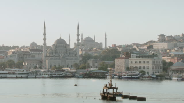ha mosques in cityscape at shoreline during sunset or sunrise - letterbox format stock videos & royalty-free footage