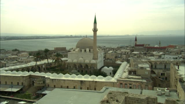 mosques surround the ruins of an ancient crusader fortress in acre. - the crusades stock videos & royalty-free footage