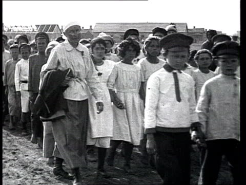 "most probably from a document about pit workers and a miners' city in the period of ""war communism"". countryside festivities w/ children and... - history stock videos & royalty-free footage"
