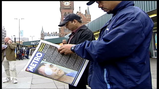 Most Requested 7/7 Heroes R08070538 Paul Dadge being interviewed King's Cross People reading Metro newspapers with Paul Dadge on front page Paul...