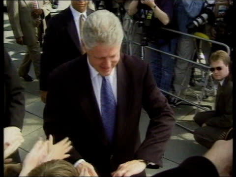 Most Requested Political Scandals TX London Bill Clinton shaking hands with crowds of people during visit to England