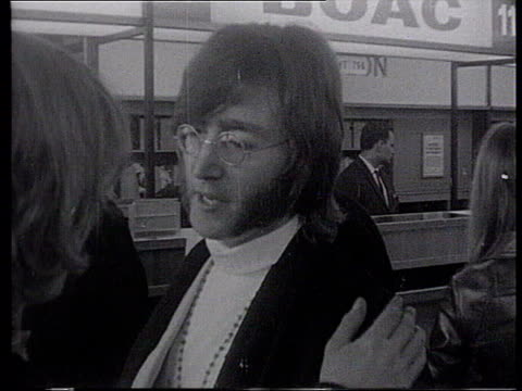 most requested rock kids 1521968 london b/w footage john lennon at airport for flight to india - john lennon stock videos and b-roll footage