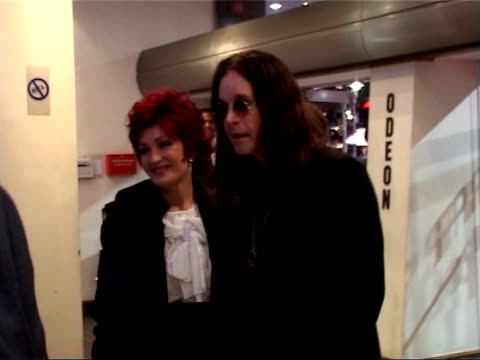 Most Requested Rock Kids R10110402 London Leicester Square Ozzy Osbourne posing with his wife Sharon Osbourne at the 2004 film premiere of 'Bridget...