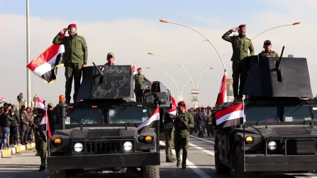 mosul which was the capital of the islamic state group in iraq for three years celebrated thursday victory over the jihadists during a military parade - iraq stock videos & royalty-free footage