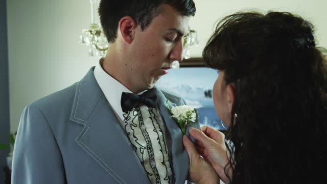 MS Mother adjusting son's tuxedo / Provo, Utah, USA