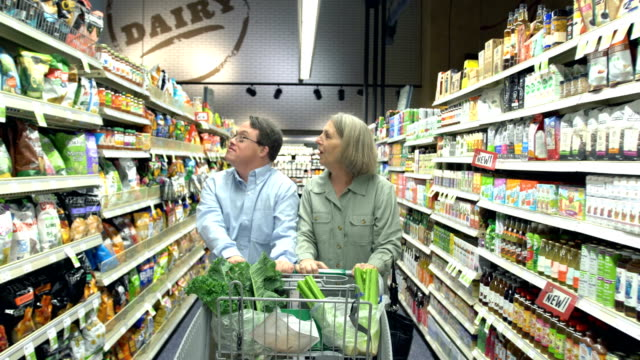 mother, adult son with downs syndrome, in supermarket - learning disability stock videos & royalty-free footage