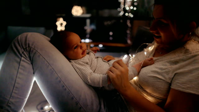 Mother and a newborn baby in a Christmasy mood