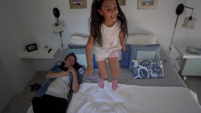 mother and a playful daughter playing on bed in bedroom - restlessness stock videos & royalty-free footage