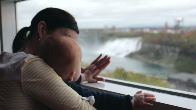 mother and baby boy at niagara falls - ontario canada stock videos & royalty-free footage