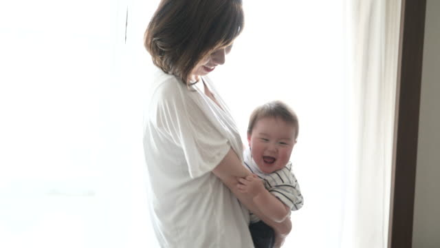 mother and baby boy having fun time in house. - japanese mom stock videos & royalty-free footage
