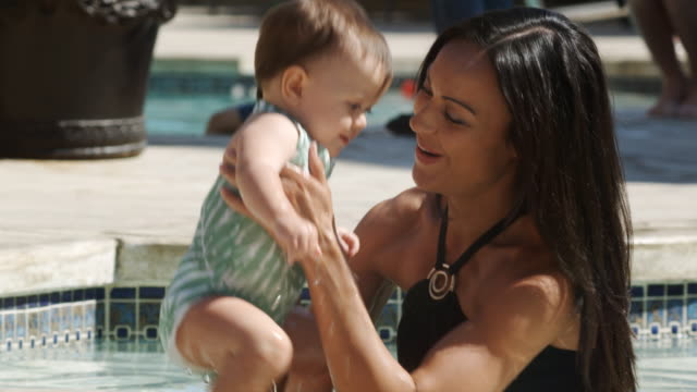 mother and baby girl in the pool - see other clips from this shoot 1421 stock videos & royalty-free footage