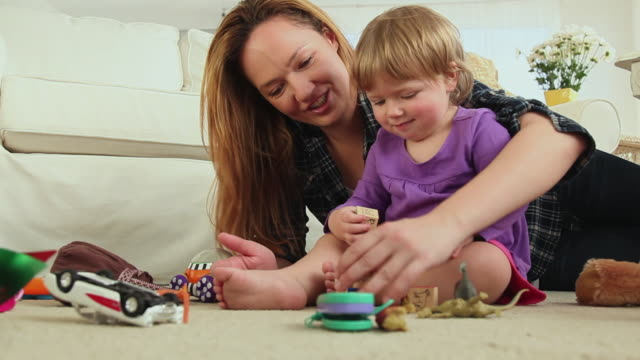 ms mother and baby girl (12-23 months) playing with blocks / jersey city, new jersey, usa - 12 23 months stock videos & royalty-free footage