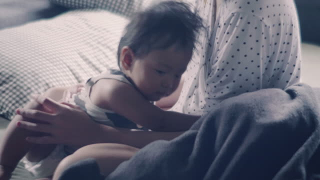 mother and baby in bed room. - waking up stock videos and b-roll footage