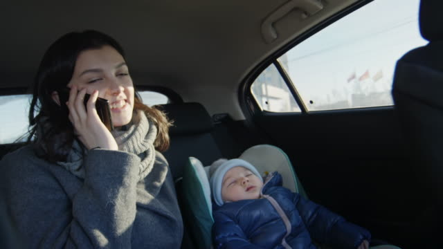 Mother and baby in moving car