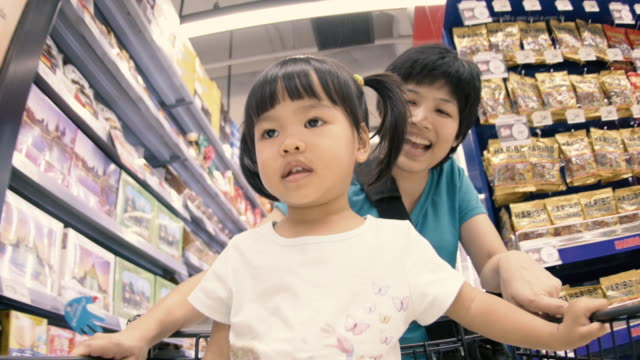 4K : Mother and Baby Shopping in supermarket