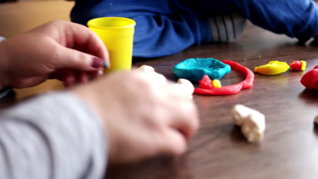 mother and boy playing with plasticine - clay stock videos & royalty-free footage