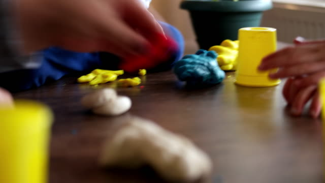 mother and boy playing with plasticine - dough stock videos & royalty-free footage