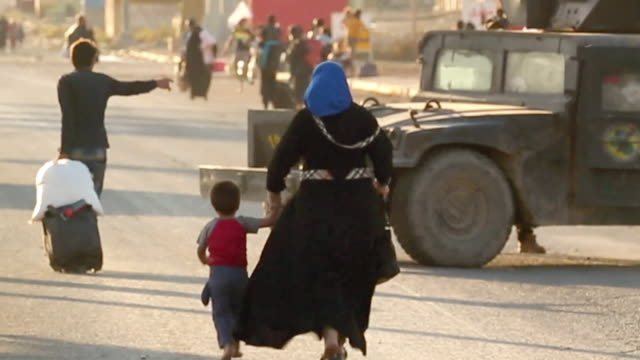 a mother and child fleeing from a section of mosul after it was liberated from islamic state by iraqi security forces - runaway stock videos & royalty-free footage