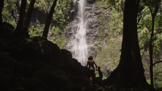 mother and child hiking to a waterfall - tahiti stock videos and b-roll footage