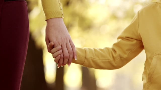 mother and child holding hands - holding hands stock videos & royalty-free footage