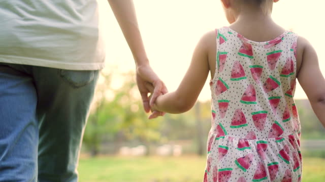 cu : mother and child holding hands - single mother stock videos & royalty-free footage