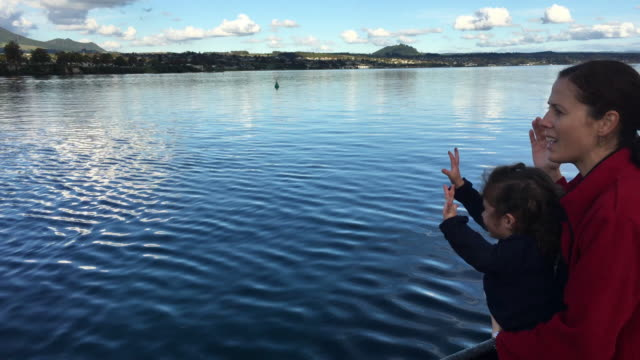 Mother and child sail on a yacht over Lake Taupo New Zealand