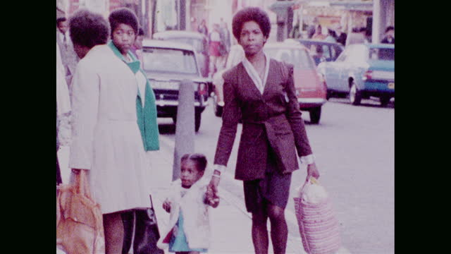 mother and child walk along street in brixton; 1973 - afro hairstyle stock videos & royalty-free footage