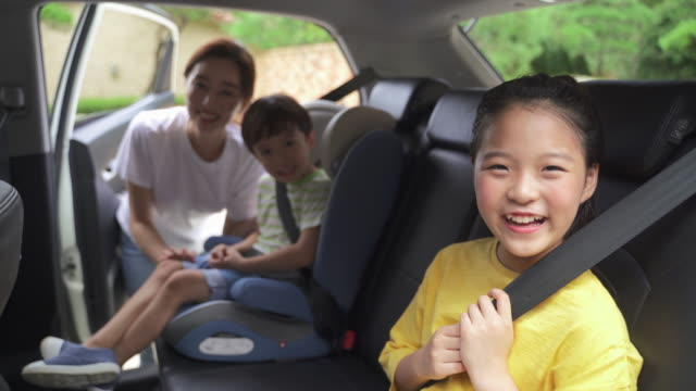 mother and child wearing seat belt smiling - affectionate stock videos & royalty-free footage