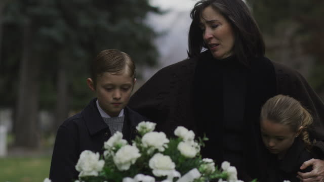 mother and children at a funeral - mourner stock videos and b-roll footage