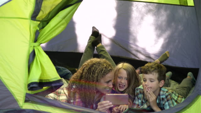 mother and children taking selfies in tent - tent stock videos & royalty-free footage