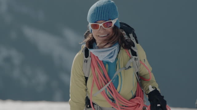 mother and daughter alpinists hike up snowy mountain in winter - poland stock videos & royalty-free footage