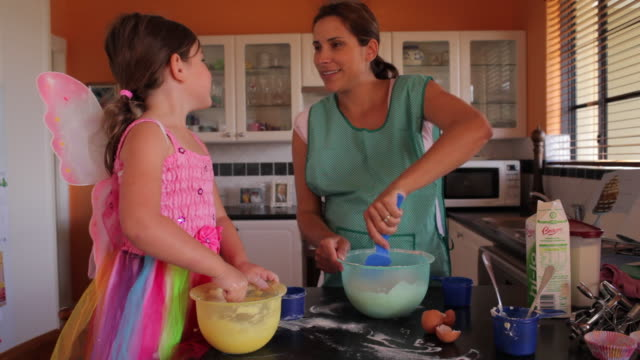 ms mother and daughter (2-3) are mixing ingredients together / perth, western australia, australia - preparation stock videos & royalty-free footage