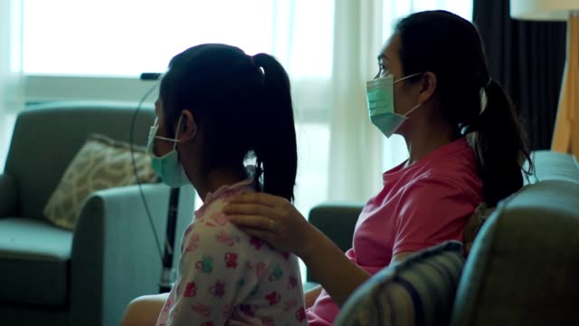 mother and daughter are wearing protective mask for protecting from coronavirus infection - infectious disease stock videos & royalty-free footage