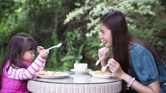 Mother and Daughter at Breakfast