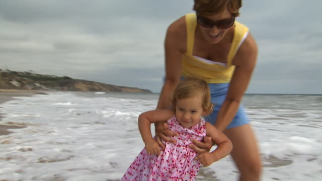 mother and daughter at the beach - see other clips from this shoot 1156 stock videos & royalty-free footage