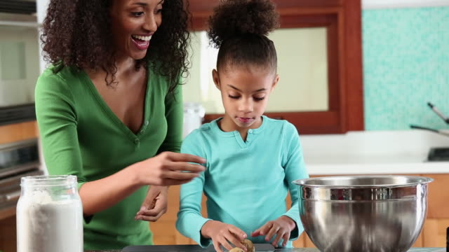 ms tu mother and daughter baking chocolate chip cookies in kitchen / richmond, virginia, usa - chocolate chip stock videos & royalty-free footage