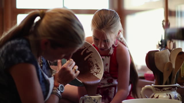 ms td mother and daughter baking in kitchen / lamy, new mexico, united states - lamy new mexico stock videos and b-roll footage