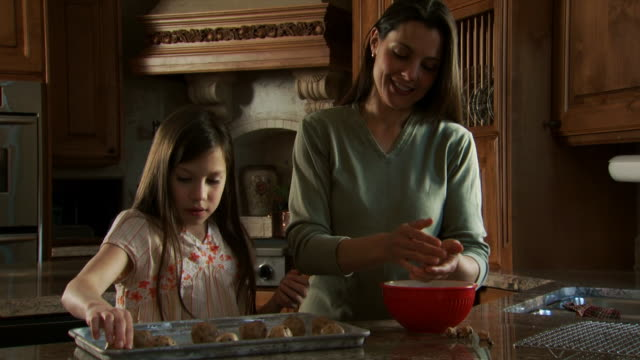 mother and daughter baking in kitchen - see other clips from this shoot 1167 stock videos and b-roll footage