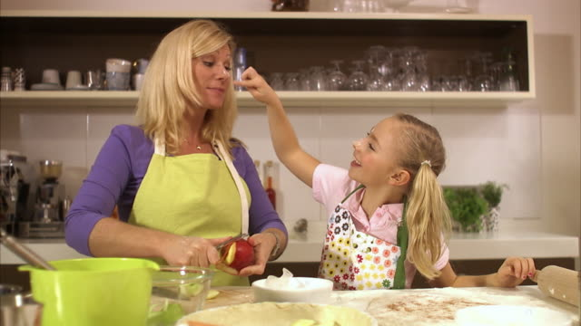 mother and daughter baking together stockholm sweden. - mother and daughter making out stock videos & royalty-free footage